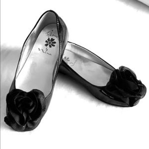 Black patent ballet flats with fabric rose